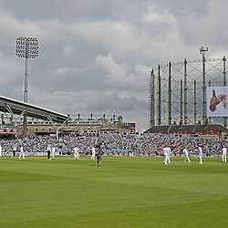 ENGLAND PLAYERS TAKE TO THE FIELD during the first day of the Investec 5th Test match between England and India at the Kia Oval, London, 15th August 2014 © Phil Duncan | SportPix.org.uk