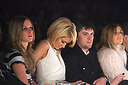 l to r: Nicky Hilton and Paris Hilton at The William Rast show held at The Tent during The Mercedes-Benz Fashion Week Fall 2009 at Bryant Park in New York City