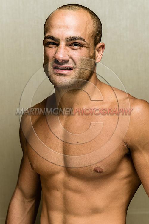 LONG BEACH, CALIFORNIA, OCTOBER 31, 2013: Eddie Alvarez poses for a portrait inside the Westin hotel in Long Beach, California ahead of their fight at Bellator CVI (© Martin McNeil)