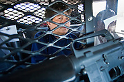 05 MAY 2003 -- SELLS, AZ:  An undocumented immigrant from the Mexican state of Jalisco sits in the back of a Tohono O'Odham police car after the driver who was smuggling the woman into the US was stopped for speeding  on AZ 86 east of Sells, AZ, the capital of Tohono OOdham Indian Reservation, May 5, 2003. The officer found six undocumented immigrants from Mexico in the back of the  truck after he pulled it over. The Tohono OOdham reservation covers a vast expanse of Southern Arizona and has a 70 mile border with Mexico. In recent years the reservation has been flooded with undocumented immigrants who pass through the reservation on their way north to Phoenix, AZ, and other cities in the US. About 1,500 undocumented immigrants, most from Mexico, cross the reservation, which has more land than the state of Delaware,  every day. According to the tribal government, the tribal police department spends about 60 percent of its resources dealing with crime created by the undocumented immigrants. Many times tribal police officers have to wait hours for the US Border Patrol to respond to calls to pick up undocumented immigrants. This woman was released by the tribal police two hours after the Border Patrol was notified that the police she was in custody. The Border Patrol didn?t respond the tribal police call because they were too busy.  PHOTO BY JACK KURTZ