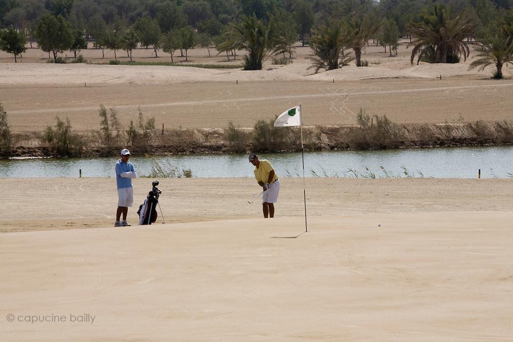 Abu Dhabi, United Arab Emirates (UAE). .March 20th 2009..Al Ghazal Golf Club..36th Abu Dhabi Men's Open Championship..Saeed Malik (right)