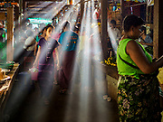 21 NOVEMBER 2017 - PANTANAW, AYEYARWADY REGION, MYANMAR: Early morning light in the market in Pantanaw, a town near Pathien in the Ayeyarwady delta.    PHOTO BY JACK KURTZ