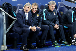 Manchester City Manager, Manuel Pellegrini sits with Assistant Managers Ruben Cousilla and Brian Kidd - Mandatory byline: Matt McNulty/JMP - 01/12/2015 - Football - Etihad Stadium - Manchester, England - Manchester City v Hull City - Capital One Cup - Quarter-final