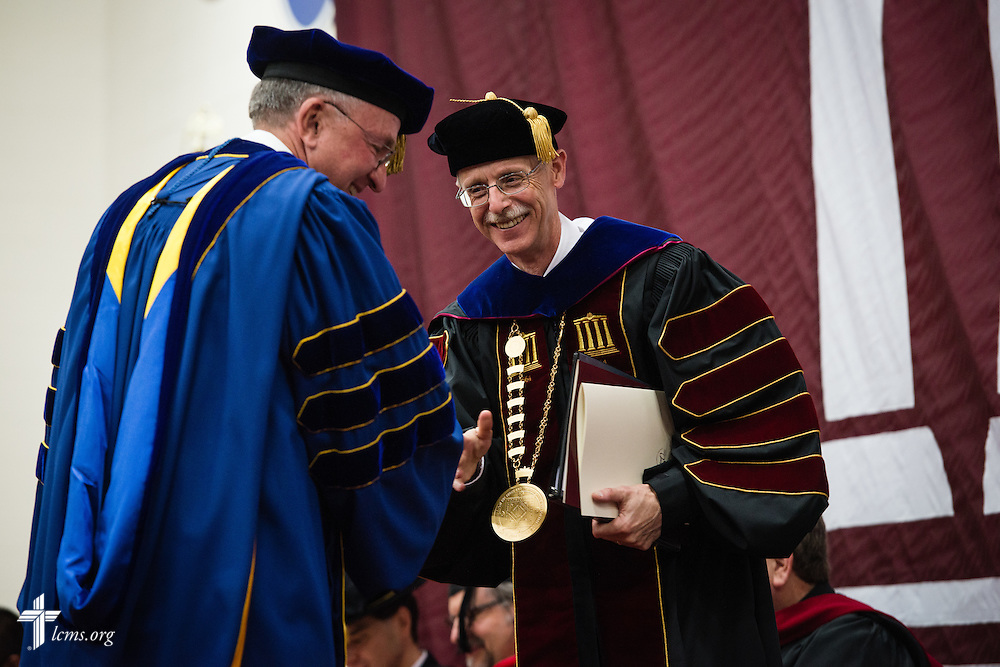 The Rev. Dr. Daniel Lee Gard, president of Concordia University Chicago, thanks the Rev. Dr. Dean O. Wenthe, president of the Concordia University System, during Gard's inauguration of at the college in River Forest, Ill., on Friday, Oct. 10, 2014. LCMS Communications/Erik M. Lunsford