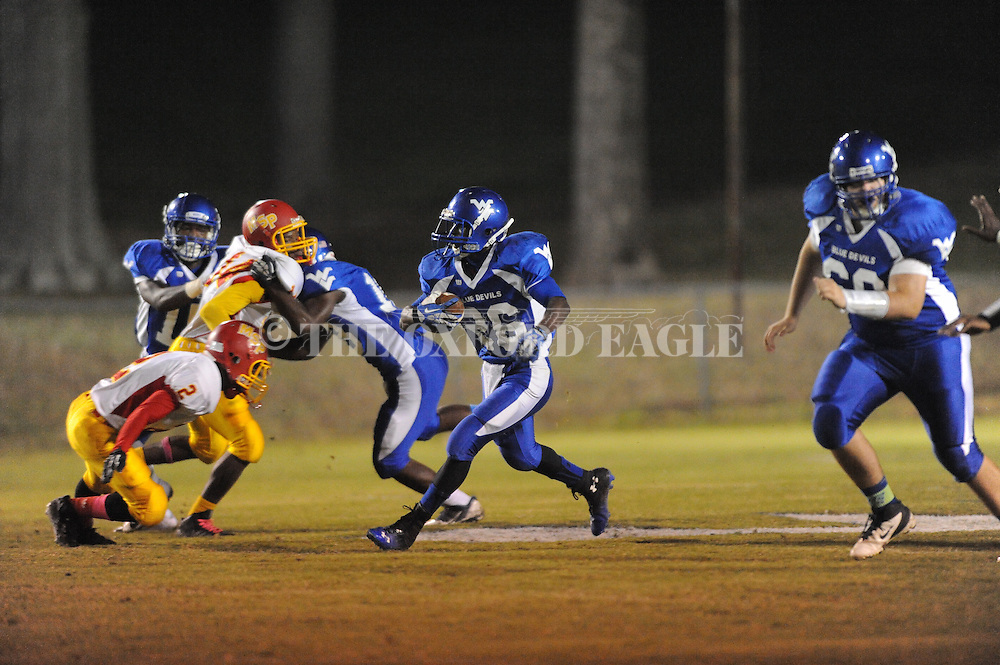 Water Valley's (2) is tackled by MS Palmer's Reginald Ragland (2) in Water Valley, Miss. on Thursday, October 30, 2014.