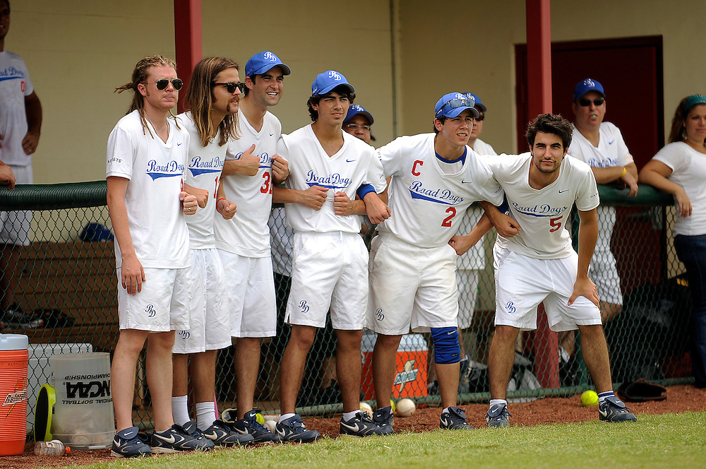 """AUGUST 19, 2009 BOCA RATON FLORIDA- Joe Jonas, center left, and Nick Jonas, of the Jonas Brothers, cheer with their teammates before the start of their  game against the Marquis Flyers. The Jonas Brothers and their team, the """"Road Dogs"""" took part in the softball game which was being held by Marquis Jet at the Saint Andrews School in Boca Raton, Fla. Marquis Jet has held 9 other softball games around the country as their company team the """"Marquis Flyers"""" competes in for fun games against various teams. PHOTO BY JOSH RITCHIE"""