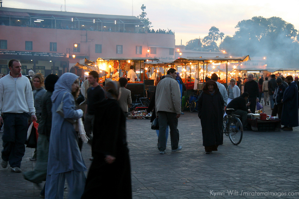 North Africa, Africa, Morocco, Marrakesh. Crowds gather in the Djeema el Fna, which transforms into a large open air restaurant by night.