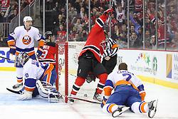 Jan 31, 2013; Newark, NJ, USA; New Jersey Devils right wing Stephen Gionta (11) and New Jersey Devils right wing Steve Bernier (18) celebrate Bernier's goal on New York Islanders goalie Evgeni Nabokov (20) during the second period at the Prudential Center.