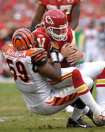 October 14, 2007 - Kansas City, MO..Linebacker Landon Johnson #59 of the Cincinnati Bengals sacks quarterback Damon Huard #11 of the Kansas City Chiefs in the first quarter, during a NFL football game at Arrowhead Stadium in Kansas City, Missouri on October 14, 2007...FBN:  The Chiefs defeated the Bengals 27-20.  .Photo by Peter G. Aiken/Cal Sport Media