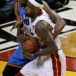 Jun 21, 2012; Miami, FL, USA; Miami Heat small forward LeBron James (6) is fouled by Oklahoma City Thunder small forward Kevin Durant (35) during the fourth quarter in game five in the 2012 NBA Finals at the American Airlines Arena. Mandatory Credit: Derick E. Hingle-US PRESSWIRE