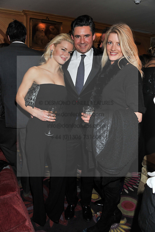 Left to right, AMY PURSSEY, EDWARD TAYLOR and CHARLOTTE BAER at the Johnnie Walker Blue Label and David Gandy partnership launch party held at Annabel's, 44 Berkeley Square, London on 5th February 2013.