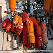 Bouys and bumpers on a commercial fishing boat, Gloucester, MA
