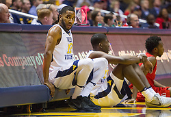 Dec 20, 2016; Morgantown, WV, USA; West Virginia Mountaineers guard Tarik Phillip (12) waits at the scorers table during the first half against the Radford Highlanders at WVU Coliseum. Mandatory Credit: Ben Queen-USA TODAY Sports