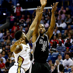 Mar 3, 2016; New Orleans, LA, USA; San Antonio Spurs forward Kawhi Leonard (2) shoots over New Orleans Pelicans forward Alonzo Gee (15) during the second half of a game at the Smoothie King Center. The Spurs defeated the Pelicans 94-86. Mandatory Credit: Derick E. Hingle-USA TODAY Sports