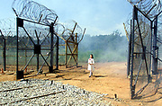 Holding a flower, a South Korean girl assuming a North Korean girl appears after opening of a gate leading into the dimilitarized zone seperating the two Koreas near Dorasan station in Paju, north of Seoul, South Korea, during a ground breaking ceremony on September 18, 2002. Long-time rivals South and North Korea began work to relink railways and roads, in landmark events symbolically piercing the world's last Cold War frontier. Photo by Lee Jae-Won (KOREA) www.leejaewonpix.com