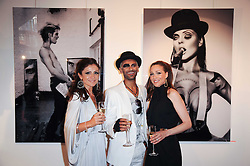Left to right, ANNASTASIA HATZVASILOU, photographer ZOOBS and GEORGIA ZARIS at a private view of an exhibition of work by artists Zoobs and Lodola held at The Opera Gallery, 134 New Bond Street, London on 16th June 2010.