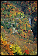 Waterfall & Iroha highway nestle in palette of autumn colors in Nikko mntns at Lake Chuzenji (v) Japan