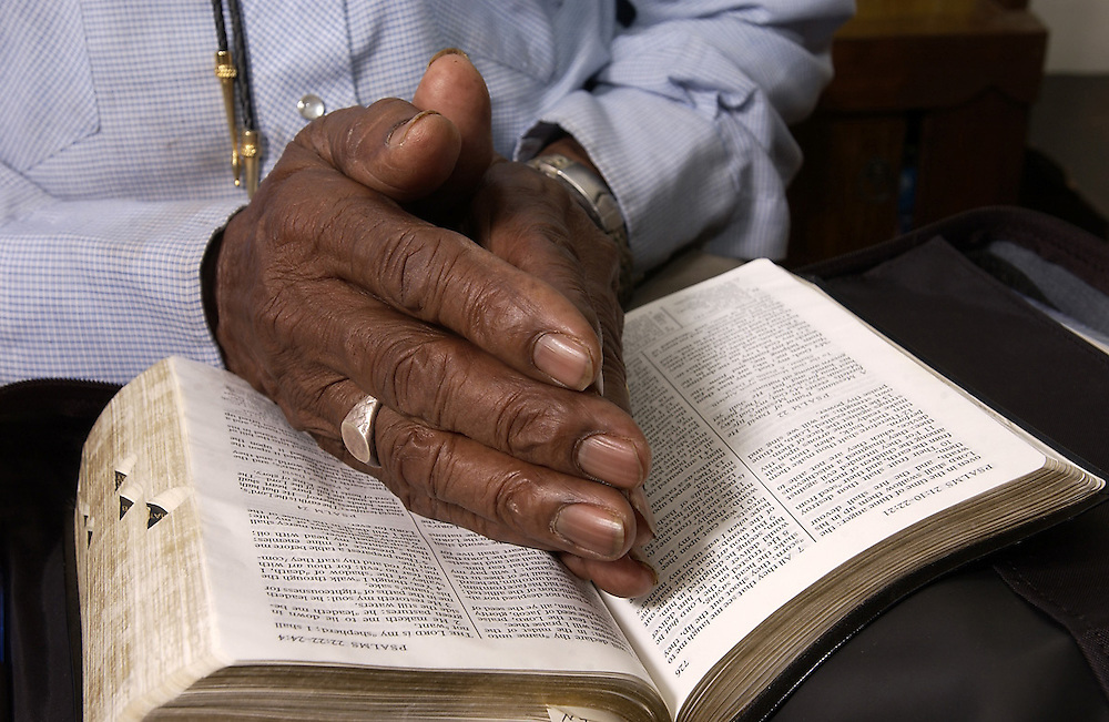 Elroy Chinn of Mountain Home, Ark., rests his hands on a Bible. Chinn learned to read at the age of 80.