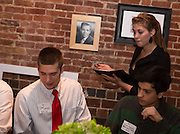 "Ariel Urbaniak takes Tyler Ondo's order during the Ohio University Homecoming ""Dinner with 12 Strangers"" event at Sol on Oct. 8, 2014. Photo by Lauren Pond"