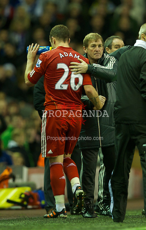 LIVERPOOL, ENGLAND - Boxing Day Monday, December 26, 2011: Liverpool's manager Kenny Dalglish substitutes Charlie Adam, whoes own-goal gifted Blackburn Rovers a point during the Premiership match at Anfield. (Pic by David Rawcliffe/Propaganda)