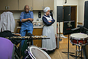 David Anderson and Carolyn Edwards wait backstage before a historical reenactment of Watch Night at Nazareth College on Tuesday, November 4, 2014. The first watch night was December 31, 1862, the night before the President Lincoln issued the Emancipation Proclamation.