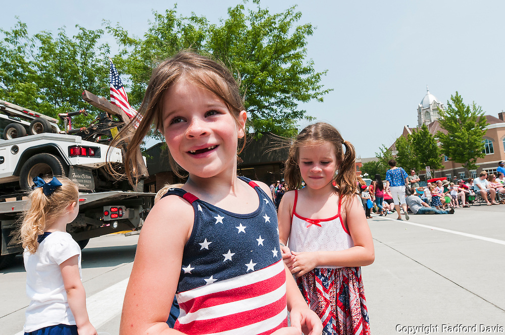 Girls enjoying Fourth of July parade in Ames, Iowa