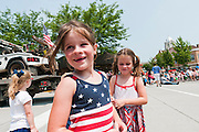 Girls enjoying Fourth of July parade in Ames, Iowa