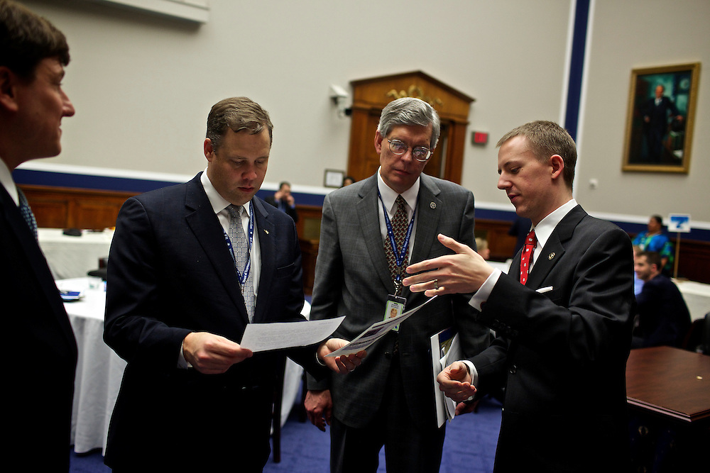 Congressman-elect Jim Bridenstine, from Oklahoma's First District, center, makes decisions about his future office, with his chief of staff Joe Kaufman, left, and the Sergeant at Arms Office of Emergency Management in the Rayburn House Office Building in Washington, DC on Nov. 30, 2012. The lengthly process included picking his office for his first term in Congress and talking with the architect about how to structure his new room.