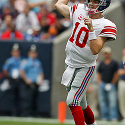 October 10, 2010; Houston, TX USA; New York Giants quarterback Eli Manning (10) throws a pass against the Houston Texans during the first half at Reliant Stadium. Mandatory Credit: Derick E. Hingle
