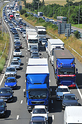 &copy; Licensed to London News Pictures. 23/07/2016<br /> M20 traffic near the Euro Tunnel Service Station at the back of a very very long queue into Dover, kent.<br /> Dover bound traffic ON THE  M20 in Kent at Junction 11A AND 12.  Queueing traffic because of very long delays at French border contol. <br /> <br /> <br /> (Byline:Grant Falvey/LNP)
