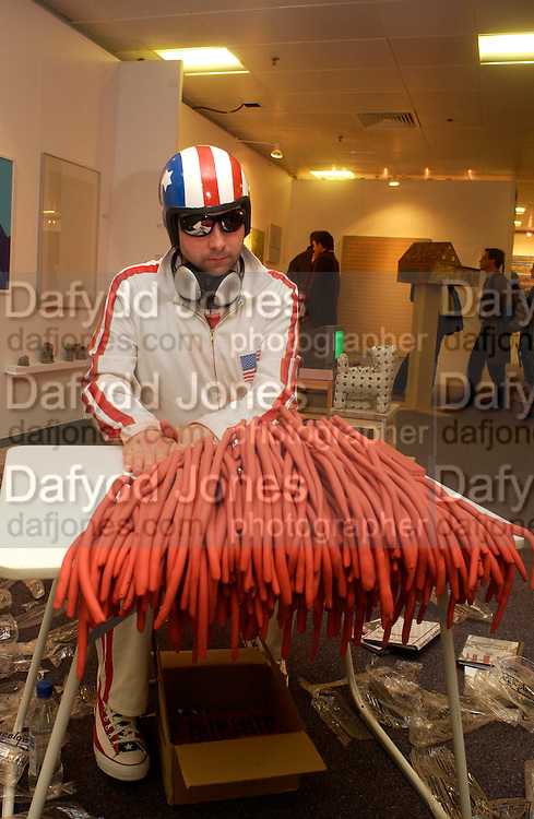 Jens Kabisch rolling plasticine as Evil Knievel in therapy, Hoxton distillery, London Art Fair preview evening, Islington Business centre. 13 January 2004. © Copyright Photograph by Dafydd Jones 66 Stockwell Park Rd. London SW9 0DA Tel 020 7733 0108 www.dafjones.com