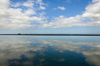 Clouds reflected in still water near Port Orford Oregon