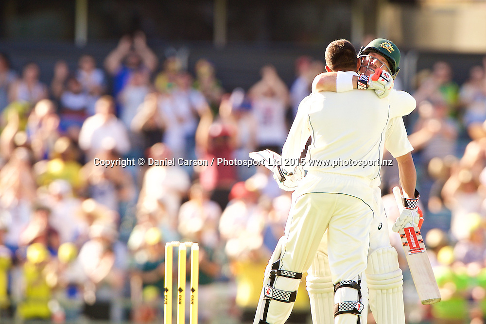 Usman Khawaja of Australia celebrates his century with David Warner of Australia  during Day 1 on the 13th of November 2015. The New Zealand Black Caps tour of Australia, 2nd test at the WACA ground in Perth, 13 - 17th of November 2015.   Photo: Daniel Carson / www.photosport.nz