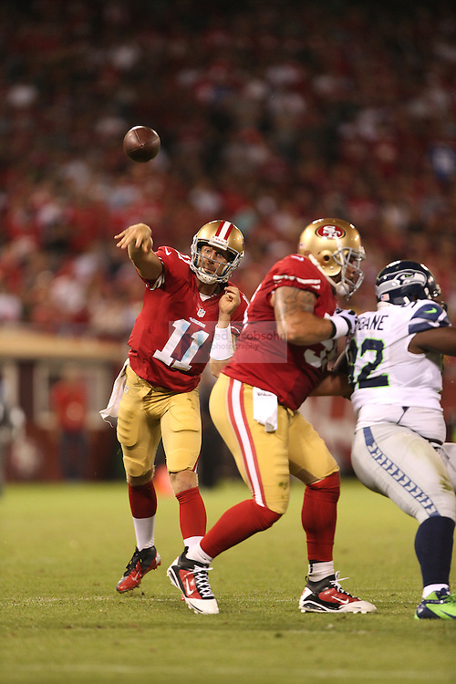 San Francisco 49ers quarterback Alex Smith (11) passes against the Seattle Seahawks on Thursday, Oct. 18, 2012 at Candlestick Park in San Francisco, CA. (AP Photo/Jed Jacobsohn)