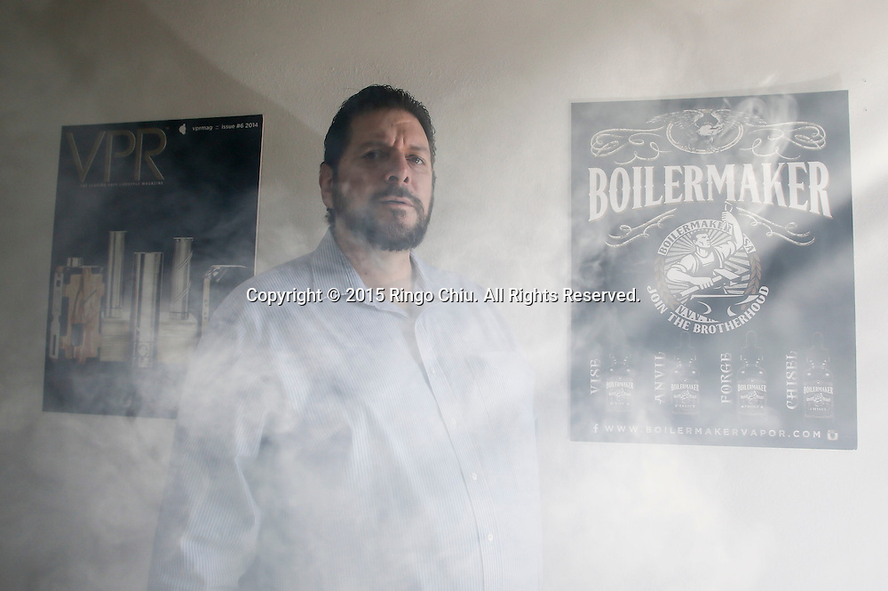 Doug Hughes of Boilermaker Vapor, who is also the president of the SoCal chapter of SFATA (Smoke Free Alternatives Trade Association).<br /> (Photo by Ringo Chiu/PHOTOFORMULA.com)<br /> <br /> Usage Notes: This content is intended for editorial use only. For other uses, additional clearances may be required.