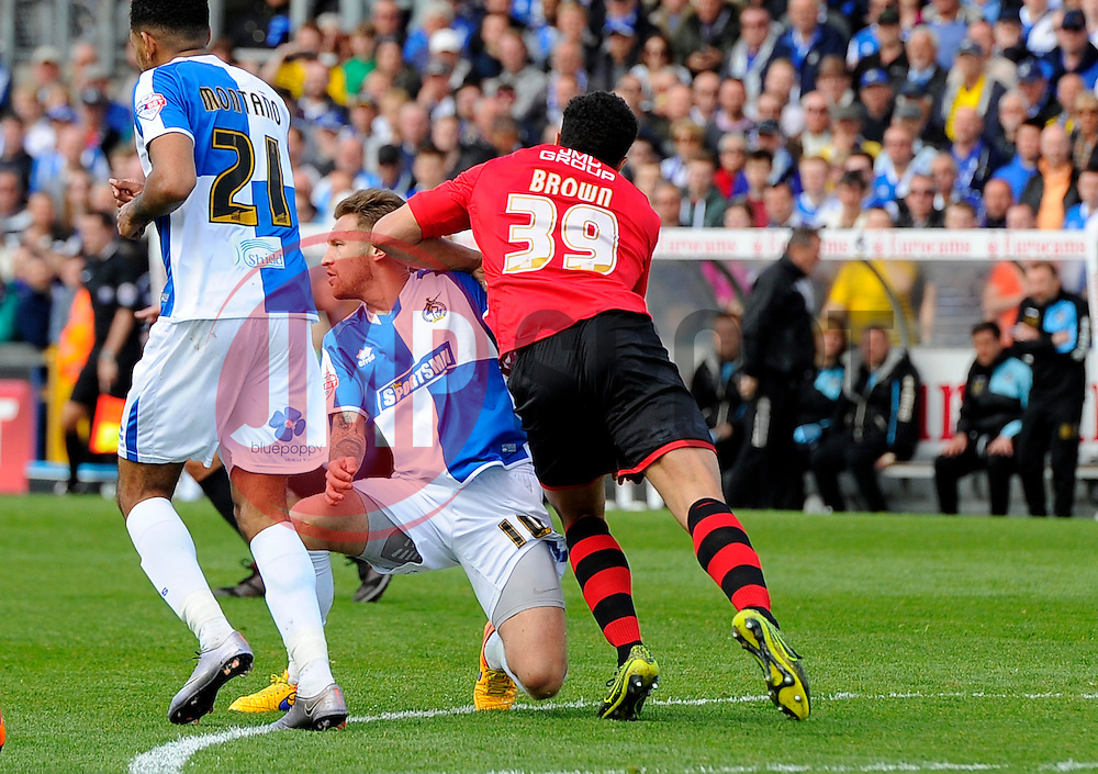 Troy Brown of Exeter City elbows Matt Taylor of Bristol Rovers in the head  - Mandatory by-line: Joe Meredith/JMP - 23/04/2016 - FOOTBALL - Memorial Stadium - Bristol, England - Bristol Rovers v Exeter City - Sky Bet League Two
