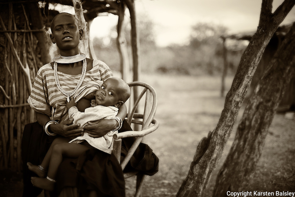 &ldquo;Mother and Child&rdquo;                               Tanzania<br /> In the Savannas of Tanzania, on the edge of the Serengeti,  live the Datoga tribe; a primitive tribe that survives by herding cattle.   No matter where you go in this world the bond between a mother and a child is the same.