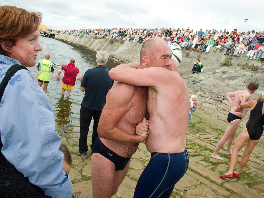 The winner of the 2005 Dun Laoghaire Harbour Swim is congratulated by a fellow swimmer. Dun Laoghaire, Co. Dublin, Ireland, August 2005.