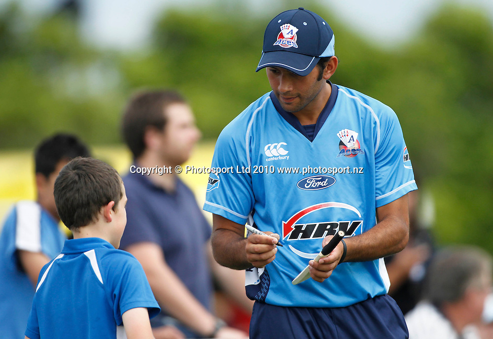 Aces Dusan Hakaraia signs an autograph. Twenty20 Cricket - HRV Cup, Auckland Aces v Central Stags, at Colin Maiden Park, Auckland, Friday 03 December 2010. Photo: Simon Watts/photosport.co.nz
