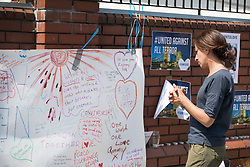© Licensed to London News Pictures. 20/06/2017. London, UK. A woman looks at messages to the community placed on a wall outside Finsbury Mosque in north London after a van ploughed into a crowd nearby. One person has been killed and 10 people are injured. Darren Osborne, 47, from Cardiff, continues to be held on suspicion of attempted murder and alleged terror offences.  Photo credit: Peter Macdiarmid/LNP