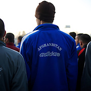November 14, 2012 - Kabul, Afghanistan: Afghan National Police (ANP) cadets line up for morning exercise at the Afghan Nacional Police Academy...ANP Academy trains 1250 cadets at the time during a period of four years. Every year, five hundred new recruits are selected, out of more than nine thousand of candidates, to join the academy and other five hundred graduate. Fifteen per cent of the recruits are women. (Paulo Nunes dos Santos/Polaris)
