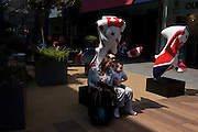 London 2012 Olympic mascots Mandeville (L) and Wenlock (R), a backdrop for family album portraits. Wenlock is named after the Shropshire town, and Mandeville after the hospital. .