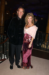 MIKE and ANGIE RUTHERFORD at the Russian Rhapsody Gala dinner concert held at The Royal Albert Hall, London on 11th April 2005.  <br />