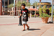 Jul 7, 2009 -- GLENDALE, AZ: TYE ROMERO, 11, from Avondale, AZ, dances like Michael Jackson during a memorial for the King of Pop in Glendale, AZ, Tuesday. About 35 people came to Westgate Center, a shopping and dining complex in Glendale, a suburb of Phoenix, AZ, to watch the memorial service for Michael Jackson. The service was simulcast live from the Staples Center in Los Angeles on jumbotrons around the complex. Photo by Jack Kurtz