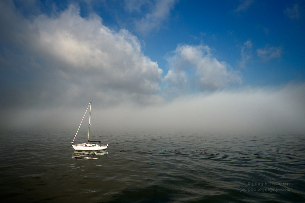 Sailboat in morning fog in New York's Upper Bay
