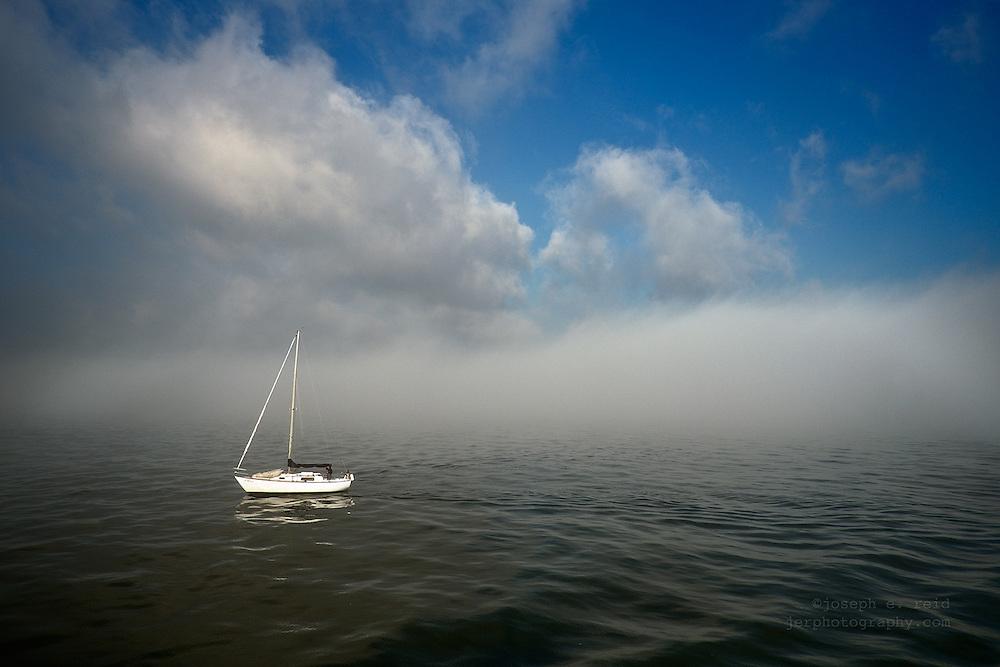 Sailboat in morning fog in New York's Upper Bay
