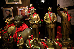 Statues of Mao Zedong are displayed for sale in a souvenir store in Shaoshan, Hunan Province in central China, 28 April 2016. Shaoshan is the hometown of former Communist leader Mao Zedong, popularly known as Chairman Mao. Thousands of visitors descend on this small Chinese town burrowed in the hills of Central China's Hunan province to pay homage to the great helmsman everyday. It is one of the core sites of the 'Red Tourism' industry, where communist party cadres and ordinary Chinese tourists alike seek to relive the experiences and rekindle the spirit of the revolutionaries.