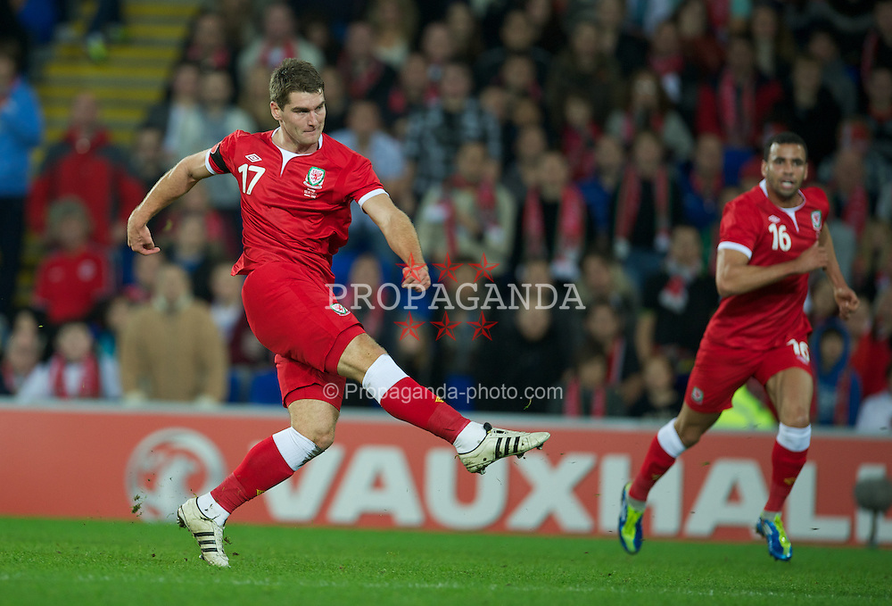 CARDIFF, WALES - Saturday, November 12, 2011: Wales' Sam Vokes scores the fourth goal against Norway during the international friendly match at the Cardiff City Stadium. (Pic by David Rawcliffe/Propaganda)