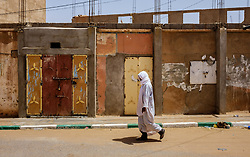A man in traditional dress walks along a street in Mhamid, Morocco<br /> <br /> (c) Andrew Wilson | Edinburgh Elite media