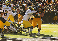 November 23 2013: Iowa Hawkeyes running back Mark Weisman (45) pulls Michigan Wolverines defensive back Raymon Taylor (6) into the end zone on a 9 yard touchdown run during the fourth quarter of the NCAA football game between the Michigan Wolverines and the Iowa Hawkeyes at Kinnick Stadium in Iowa City, Iowa on November 23, 2013. Iowa defeated Michigan 27-24. Iowa defeated Michigan 24-21.